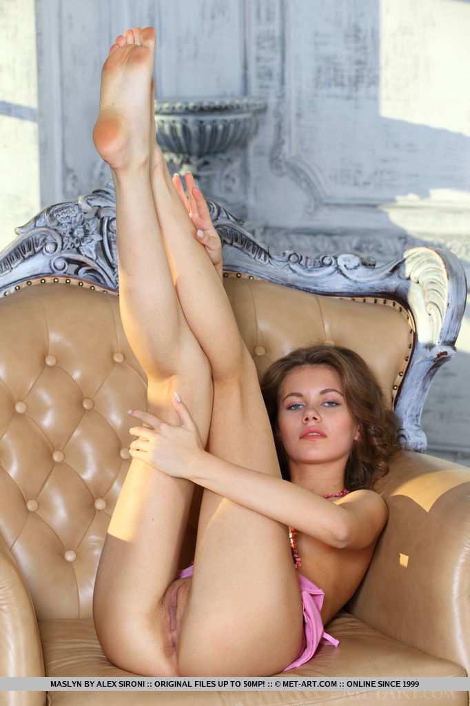 Maslyn undresses her pink night dress baring her petite body and tight ass she   poses on the sofa.