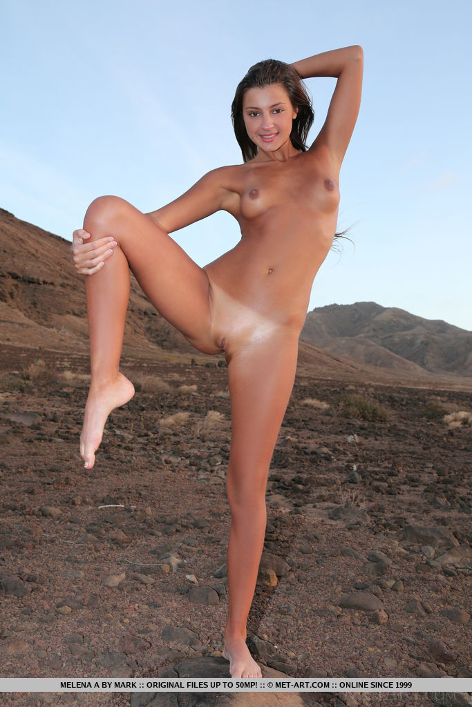 Melena A bares her smoking body as she poses outdoors.