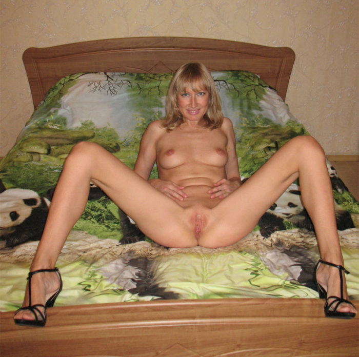 Olya Fey proudly flaunts her carefully trimmed bush and exquisite pussy