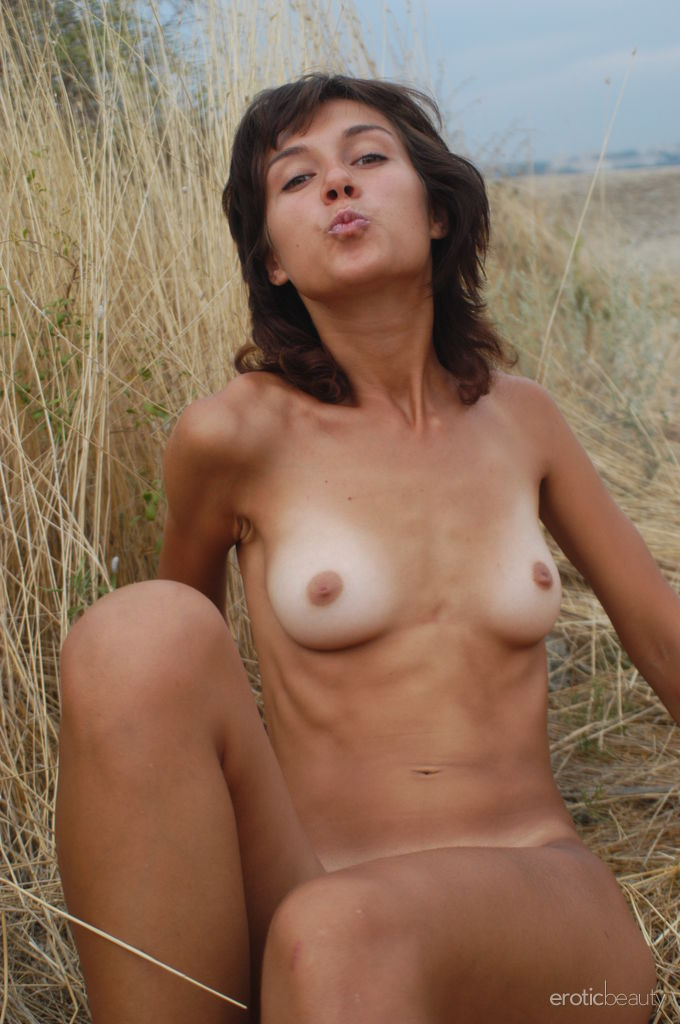 Newcomer Mary A bares her naked, tanned body with gorgeous abs as she playfully poses in the outdoors.