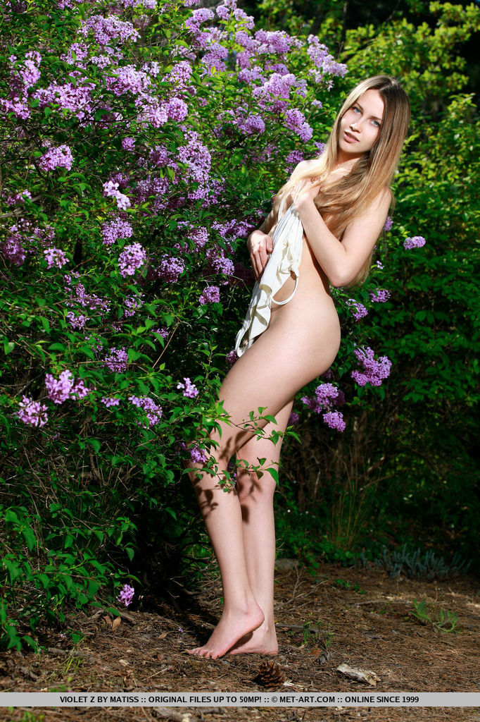 Newcomer Violet strips her one-piece bikini baring her petite body and pink   pussy as she poses in the garden.