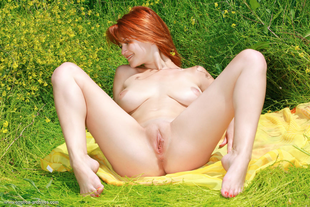 Redhead Violla A bares her sweet ass and big tits outdoors.