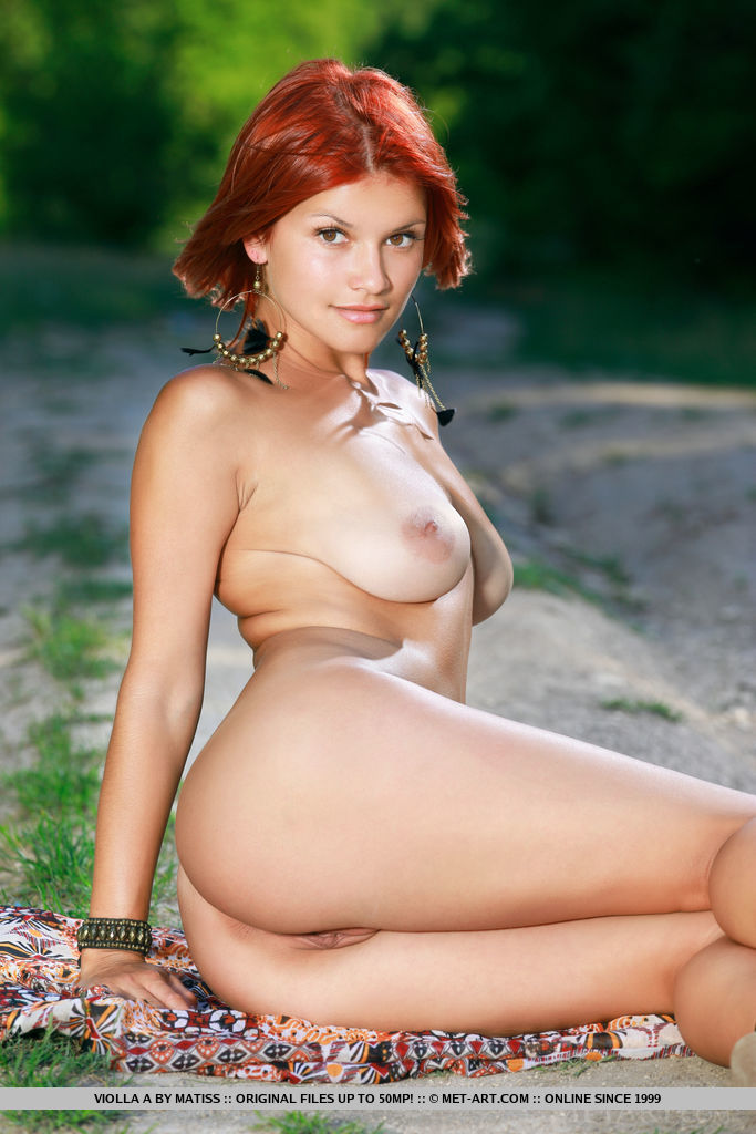 Redhead Violla A strip outdoors baring her curvy body.