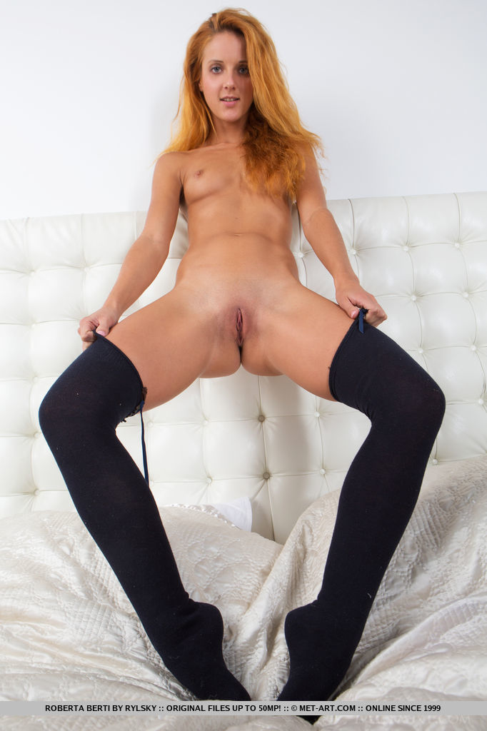 Roberta Berti poses in front of the camera showing with her thigh-high socks,   slender body and delicious pussy.