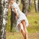Russian blonde Aljena A with sporty body in the woods