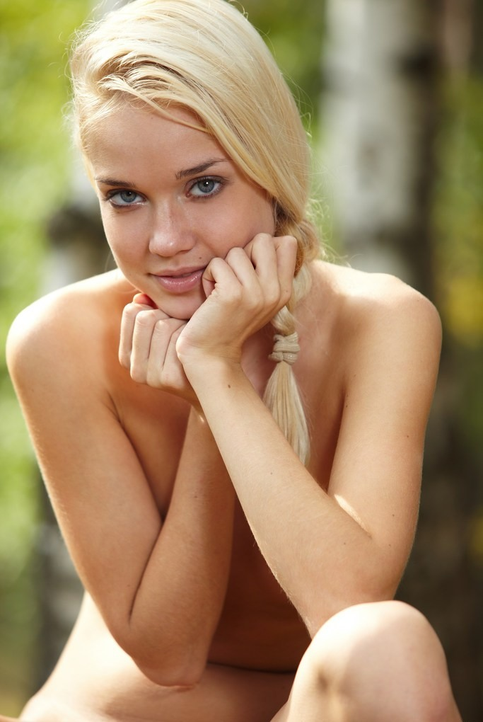 Russian blonde with sporty body in the woods