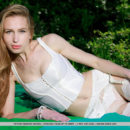 Tiffany Bene shows off her sexy white lingerie and stockings as she poses outdoors.