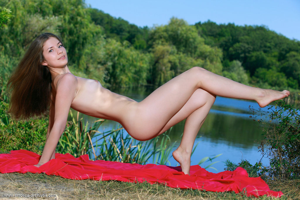 Vivian delightfully poses outdoors as she flaunts her slender body.