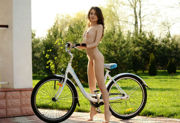Beautiful girl Nicolina posing with bycicle