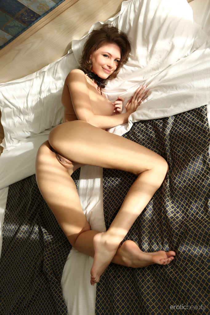 Galina A sensually strips on the bed baring her sexy, slender body.