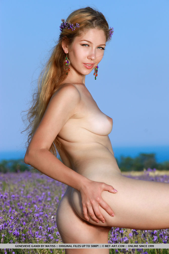 Genevieve Gandi shows off her delectable pussy as she poses outdoors.