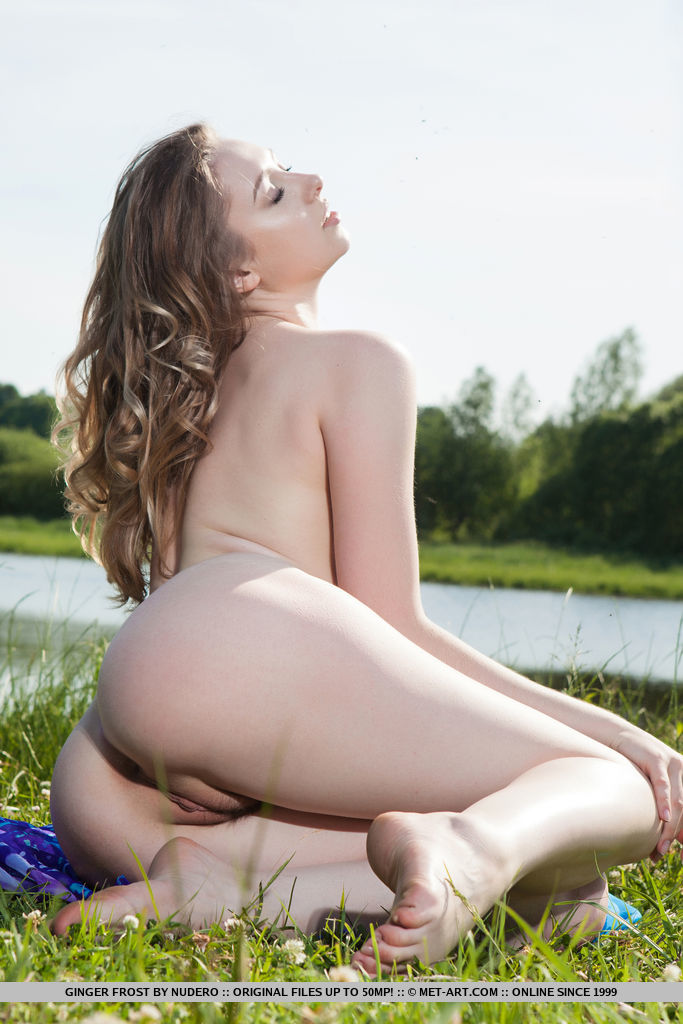 Ginger Frost displays her creamy, white body and pink pussy outdoors.