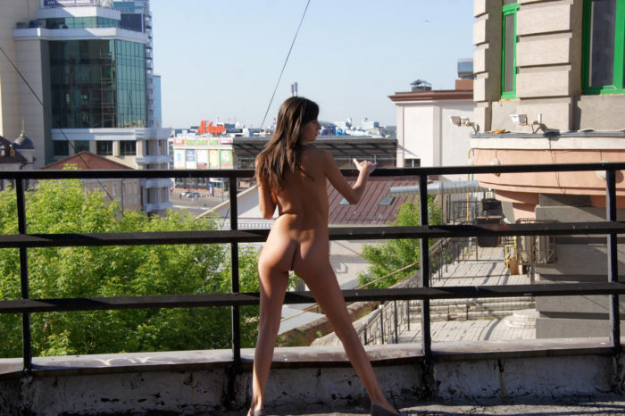 Hot teen Irina B walks naked at morning city
