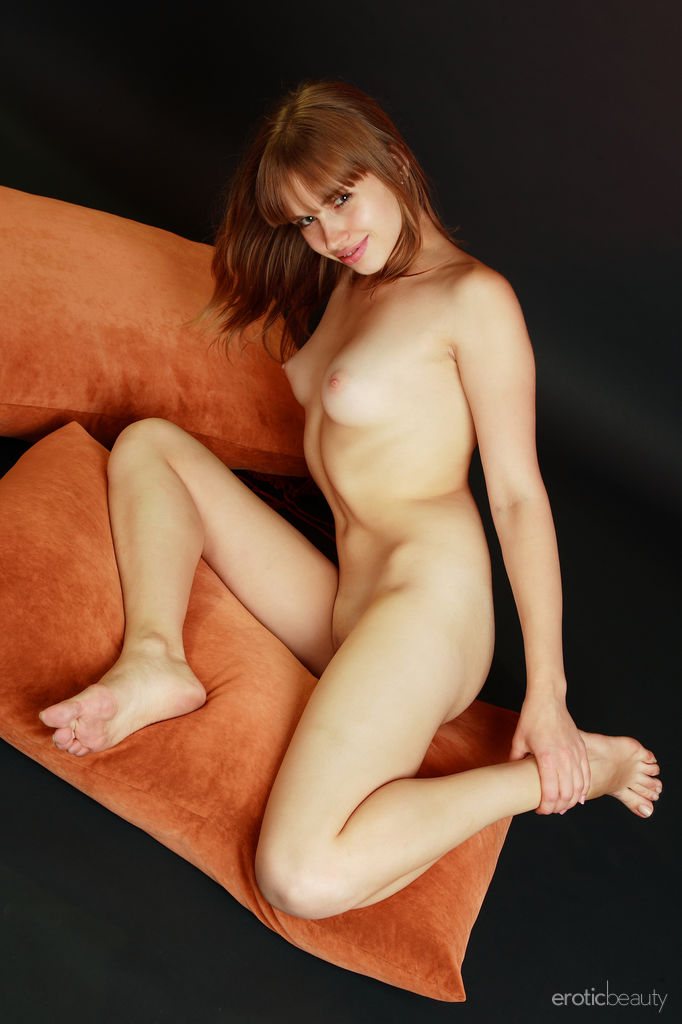 Natalia G flaunts her curvy hips and perky tits as she poses on the floor.