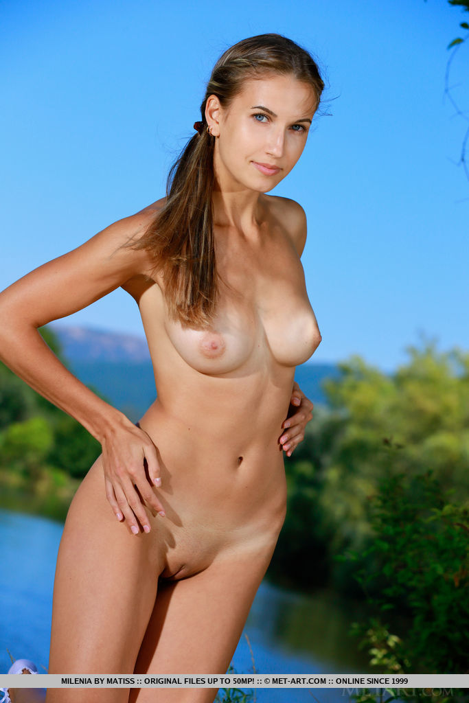 Newcomer Milenia shows off her sexy, slender body outdoors.