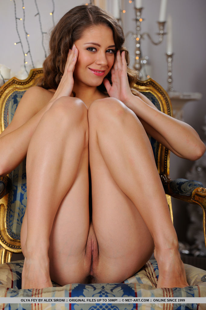Olya Fey strips on the chair as she bares her slender body and smooth pussy.