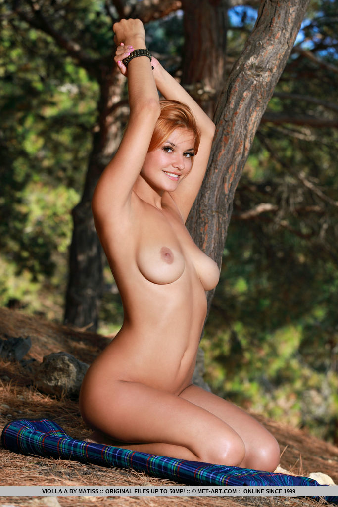 Redhead Violla A bares her smoking body and puffy tits outdoors.