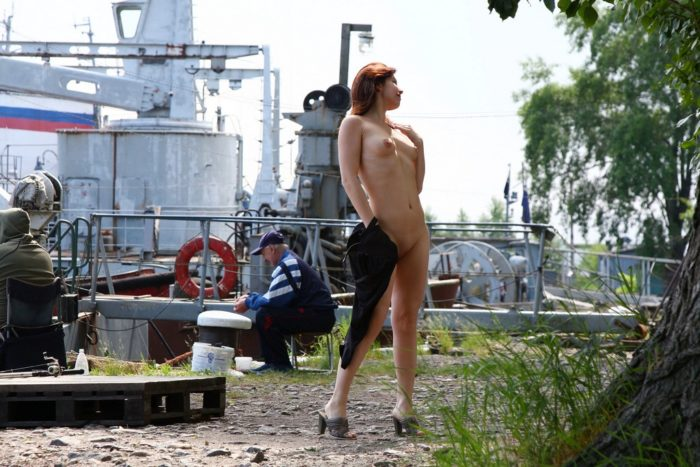 Russian girl Vika undresses near fishermen