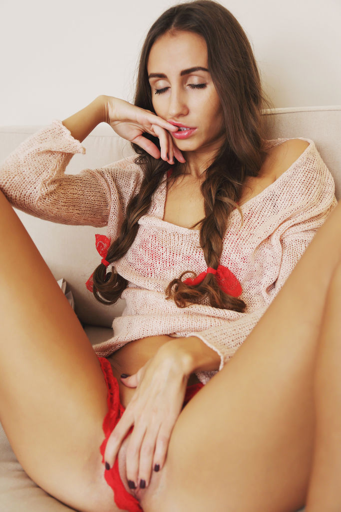 Sandy A in cute braided pigtails, performing a slow and sensual striptease until she reveals her shaved snatch