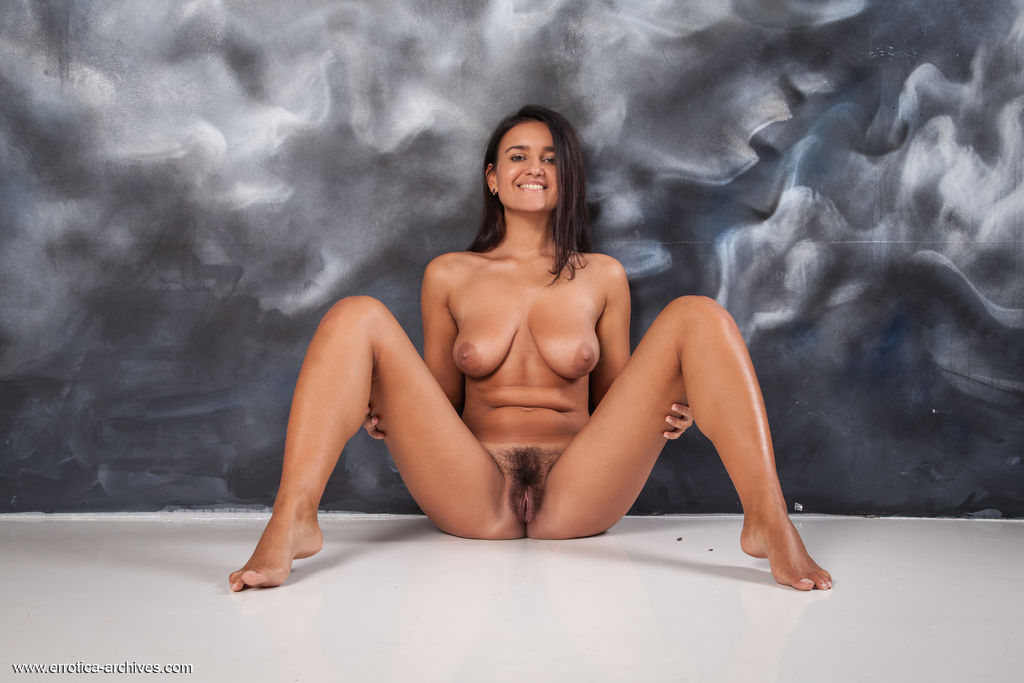 Sanita bares her beautiful tits and hairy pussy.