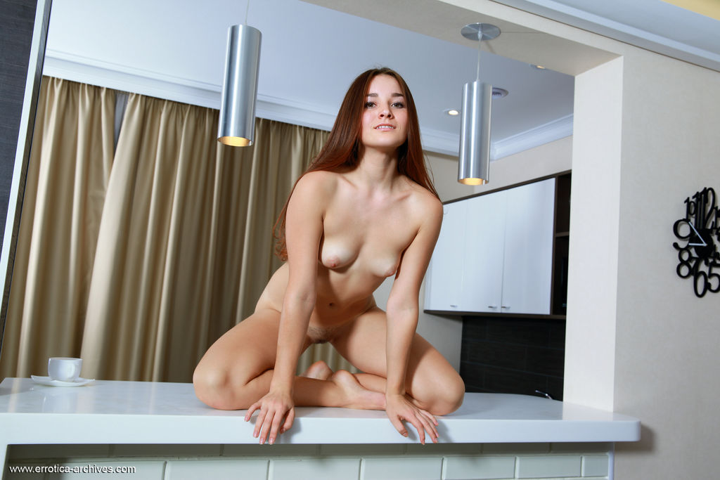 Stefany Sonri shows off her gorgeous body and trimmed pussy in the kitchen.