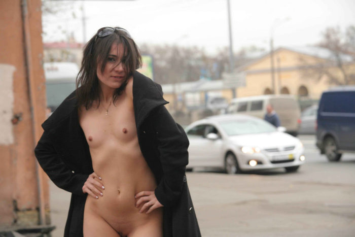 Young russian girl touches her big pussy at public