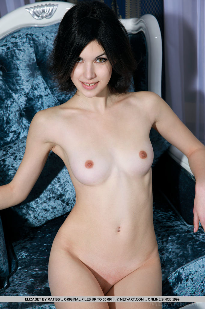 Against a bright blue set, Elizabet's smooth, creamy complexion stands out, especially her lean physique and scrumptious pink nipples