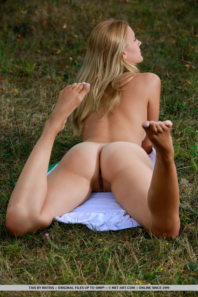 Beautiful Tais flaunts her delectable butt outdoors.