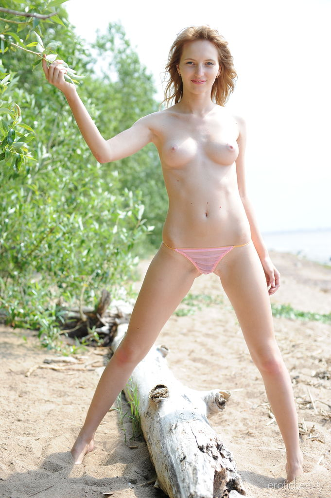 Eriska A displays her smooth, creamy body with puffy tits on the beach.