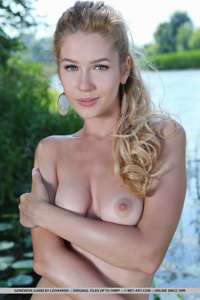 Genevieve Gandi	sensually poses in the river.