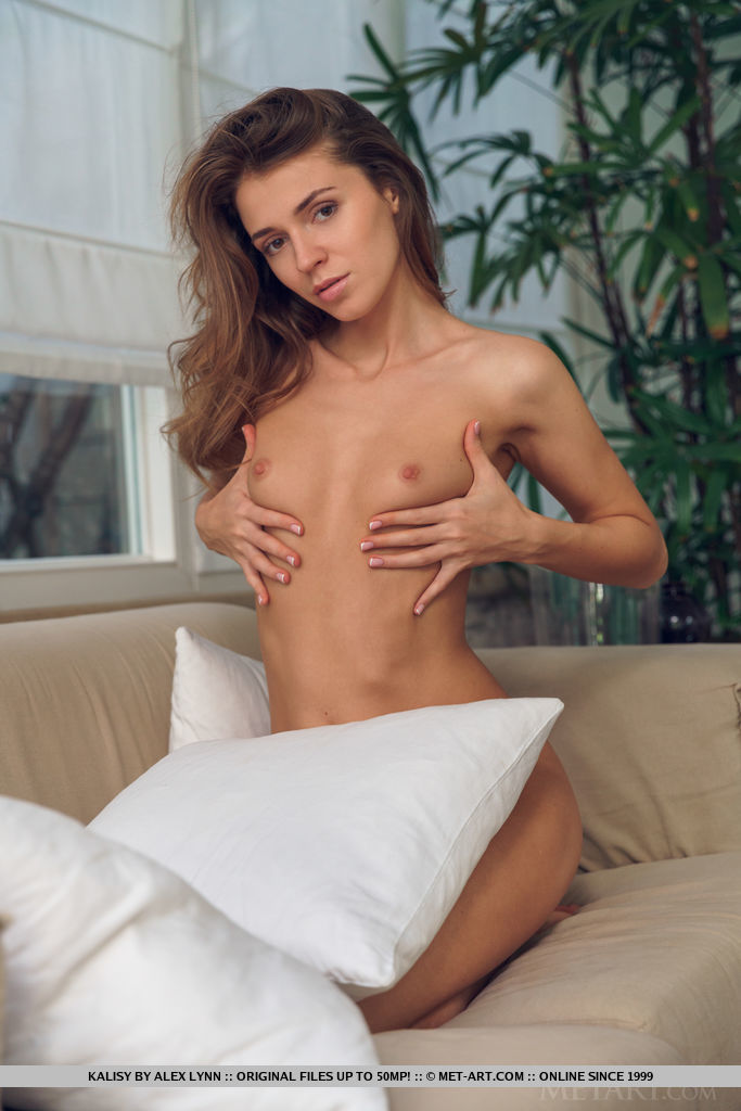 Kalisy strips on the sofa as she shows off her slender body and delectable pussy.