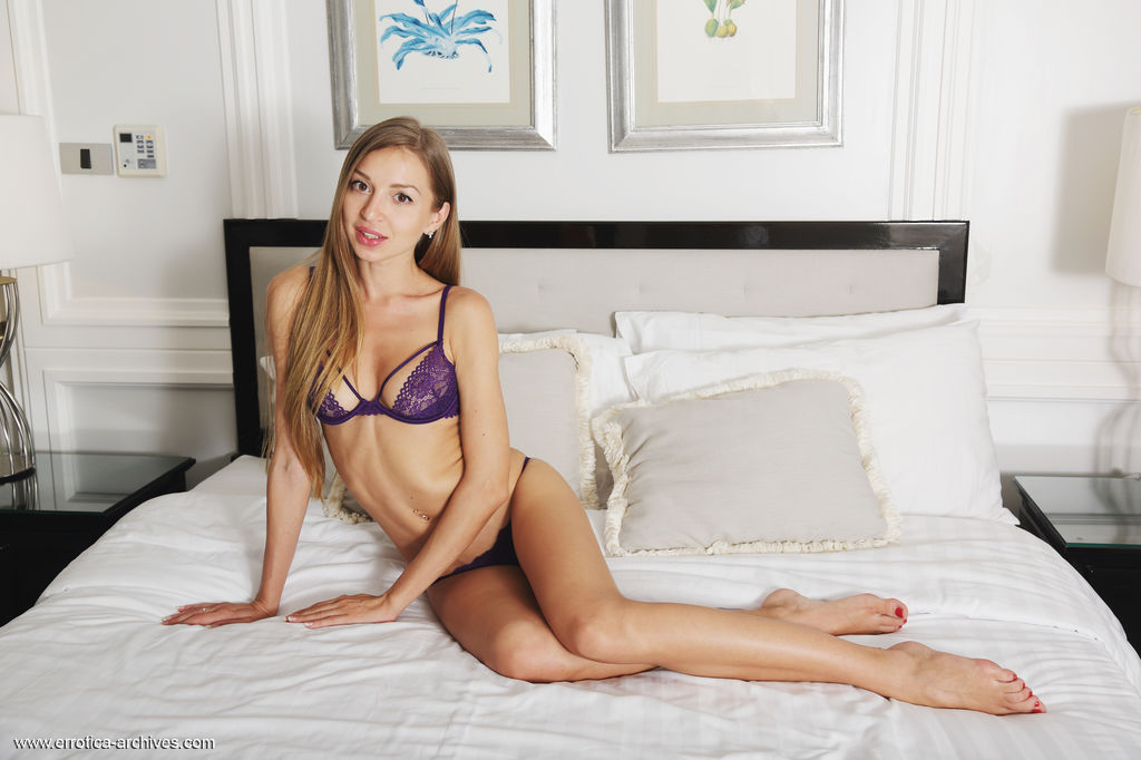 Leila Mazz strips her sexy purple lingerie   baring her lean, tight body as she poses on the   bed.