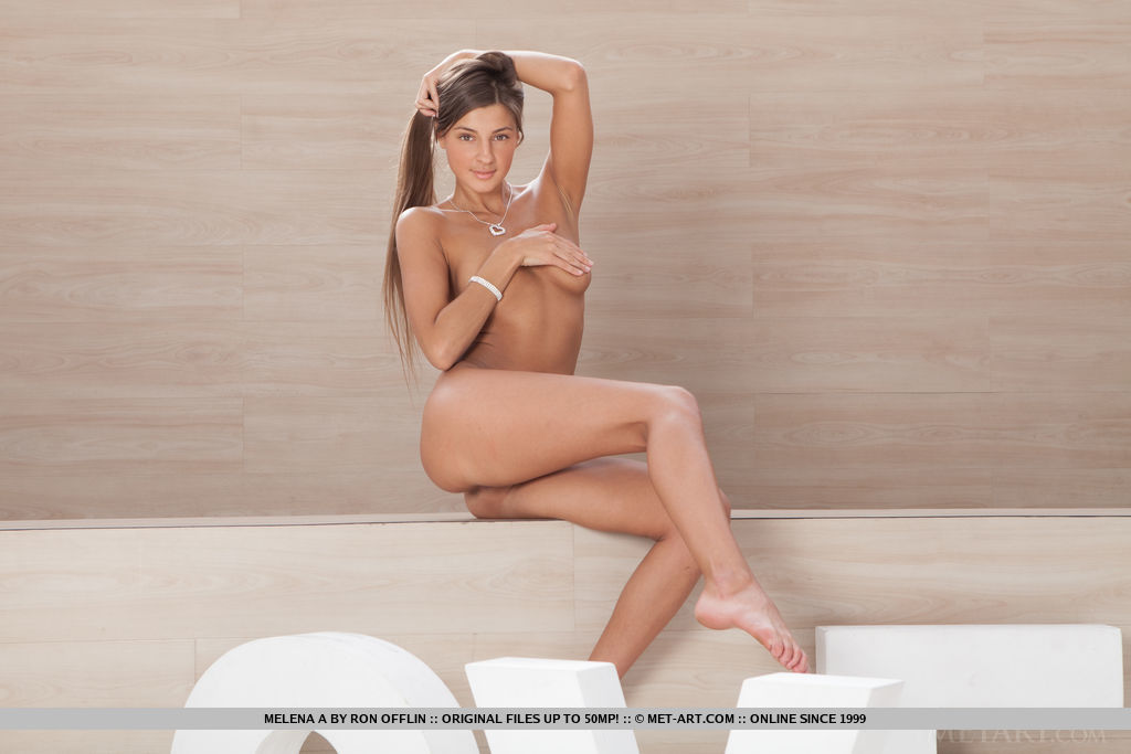 Melena A bares her smoking hot body in front of the camera.