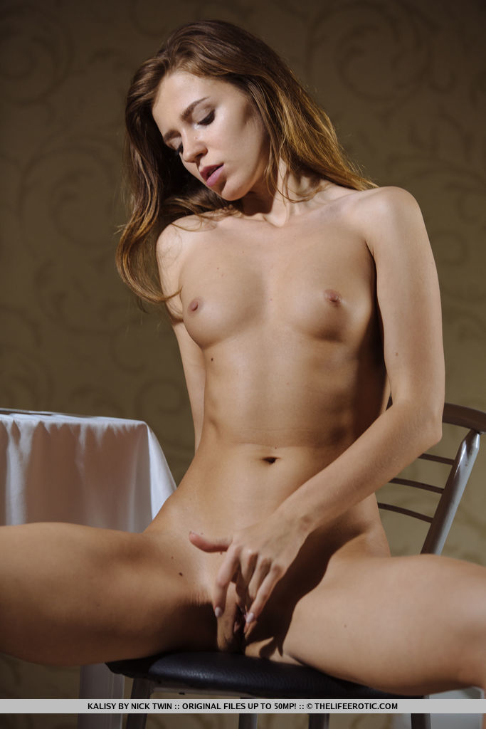 Newcomer Kalisy bares her sexy, tight body as she strips on the chair.