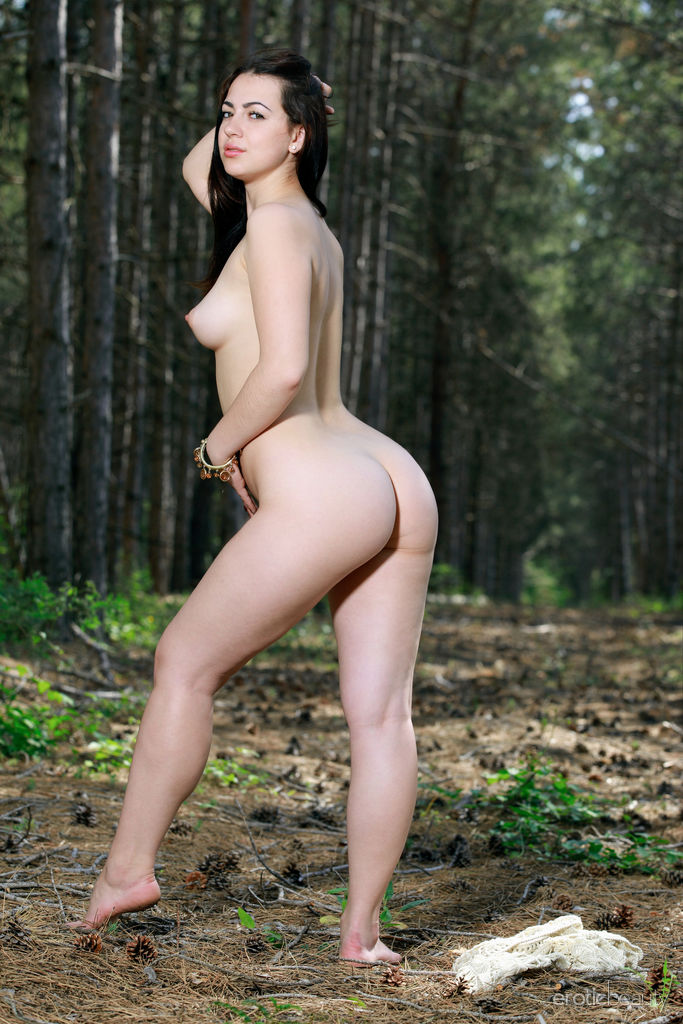Newcomer Sivilla bares her luscious body and meaty ass in the forest.