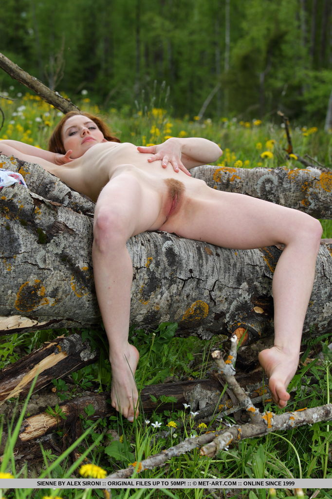 Redhead Sienne playfull poses in the outdoors she bare sher petite body with unshaven pussy.