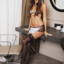 Sandy A in sexy French maid lingerie with matching apron and thigh-high stockings