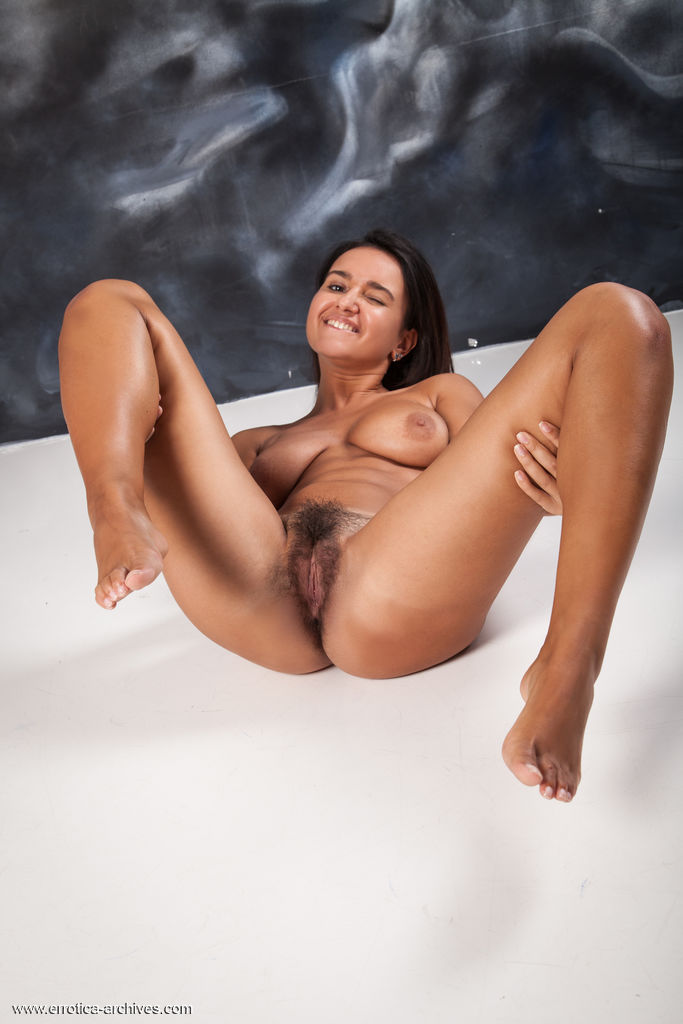 Sanita displays her unshaven pussy in front of the camera.