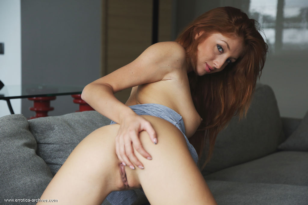 Seductive Micca plays with her lusty body and yummy pussy as she   poses sensually on the sofa.