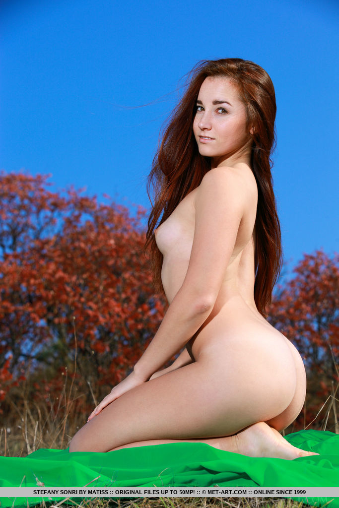 Stefany Sonri strips outdoors as she flaunts her sexy, tight body.