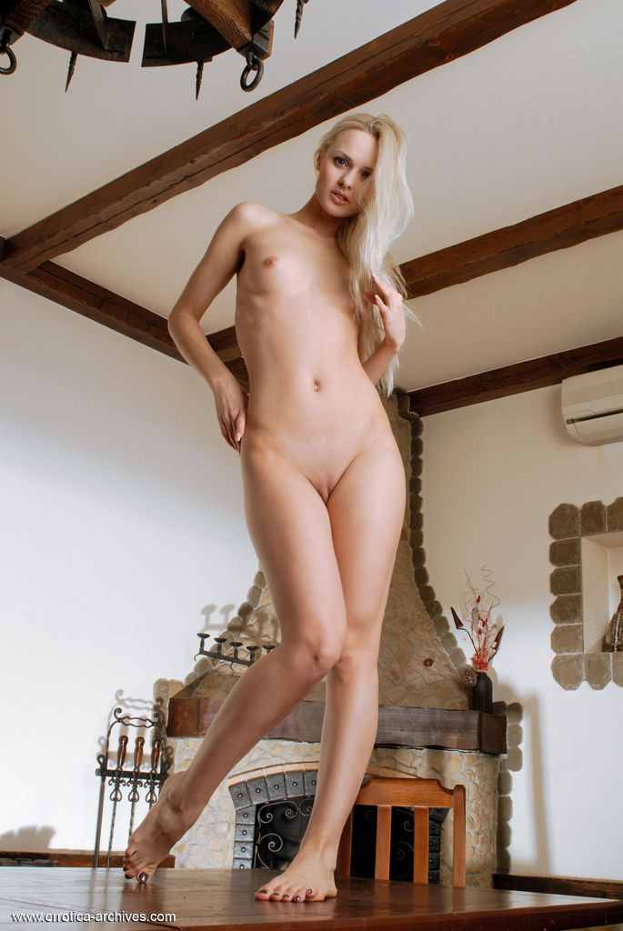 Vika T displays her sexy, slender body and   delectable pussy as she poses erotically on top   of the table.