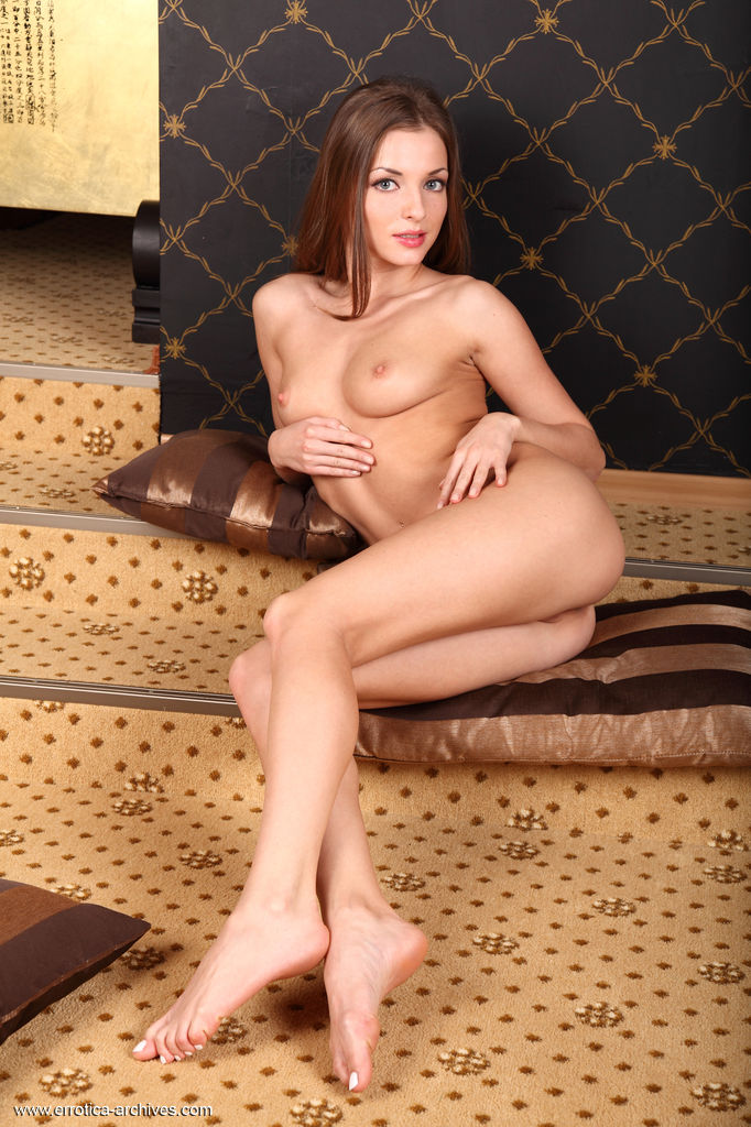 Alluring Giulia bares her slender, naked body, smooth, yummy   pussy as she poses on the bed.
