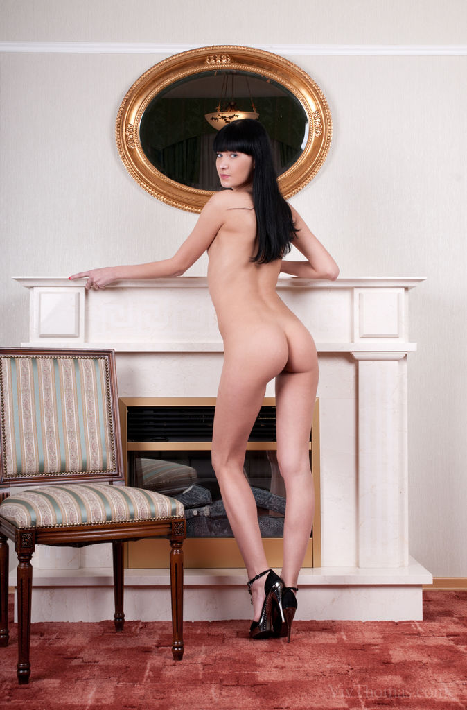 Lenore flaunts her creamy, smooth body with pink puffy nipples and pink delectable pussy as she poses on the chair.