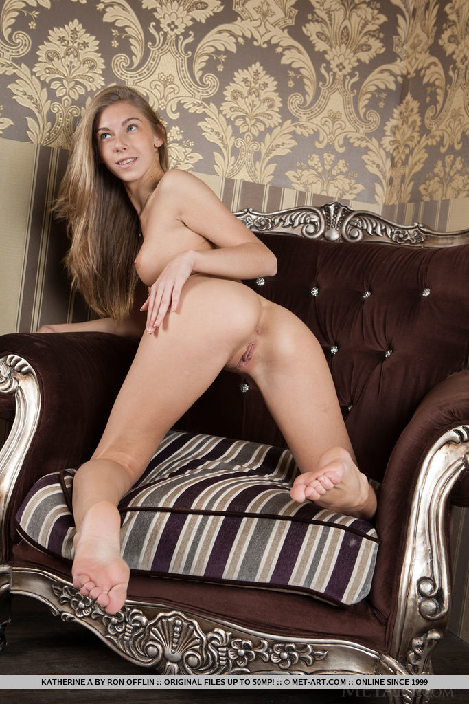 Katherine A bares her petite body and delectable pussy on the couch.