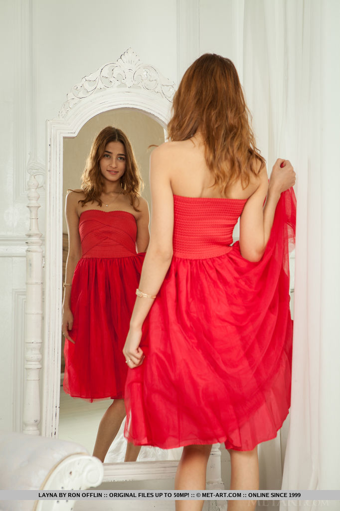 Layna looks absolutely stunning in an off-shoulder red dress and matching peep-toe stilettos.