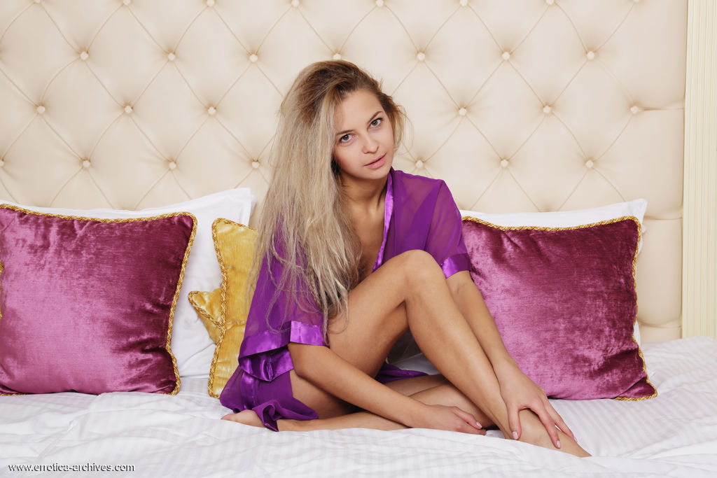 Leonie sensually poses on the bed baring her slender body and sweet pussy.
