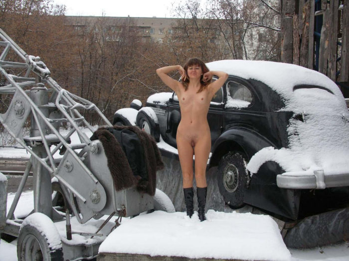 A girl who likes to walk naked in a snow-covered city