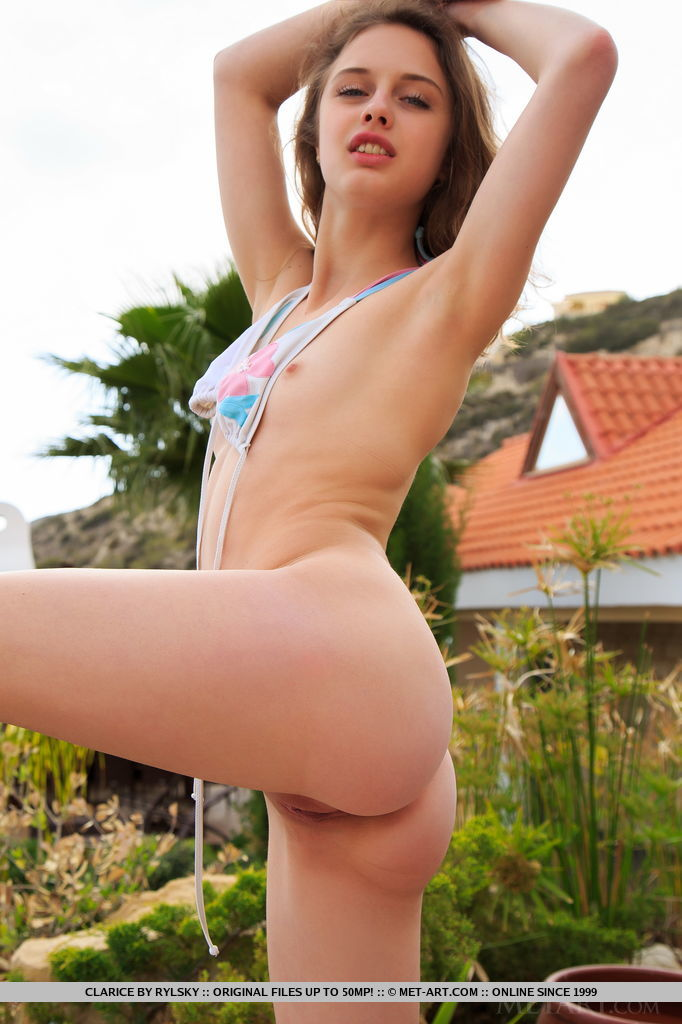Clarice shows off her beautiful ass and pink pussy outdoors.