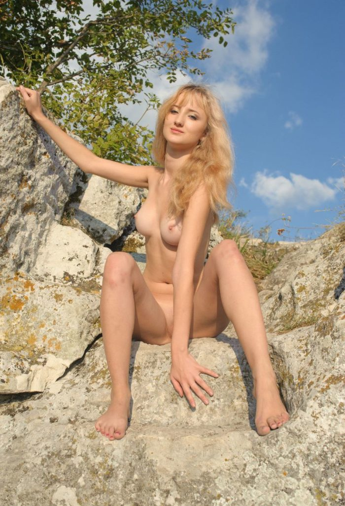 Dazzling blonde Zemira A in the rocks