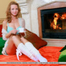 Diana Bronce strips by the chimney baring her petite body and smooth pussy.